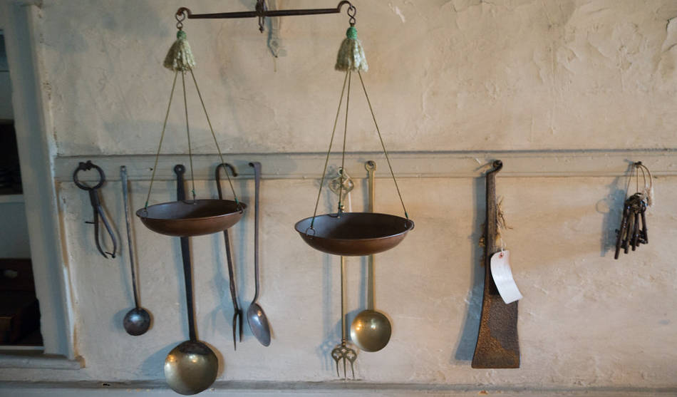 18 ancient Indian cooking utensils in a traditional kitchen